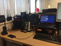 Communications desk within the Southampton City Resilience Office  at Delta Golf 20 showing Marine VHF, Analogue Amateur radio, Airwave, Citizen Band, Digital Amateur radio, Local Resilience Forum Digital Mobile radio, Digipeater, Back up Broadband, Satellite phone and Licensed PMRs.